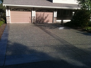 Aggregate driveway with stamped concrete border