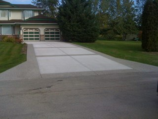 Concrete driveway with aggregate border