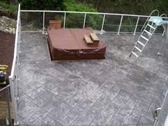 stamped concrete hot tub deck