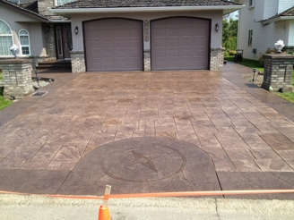 decorative stamped concrete driveway with compass