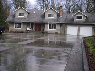 Driveway with swirl, exposed and stamped concrete