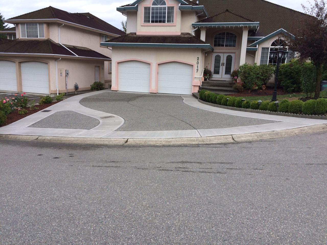 broomed and exposed aggregate concrete driveawy