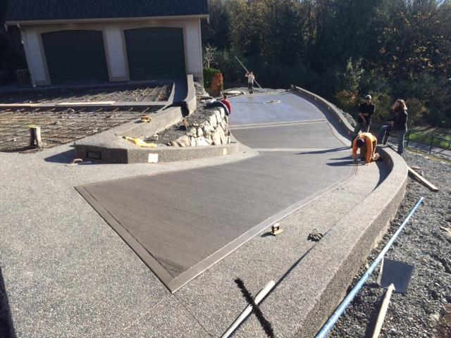 Broomed concrete driveway in abbotsford captain concrete for Temperature to pour concrete driveway