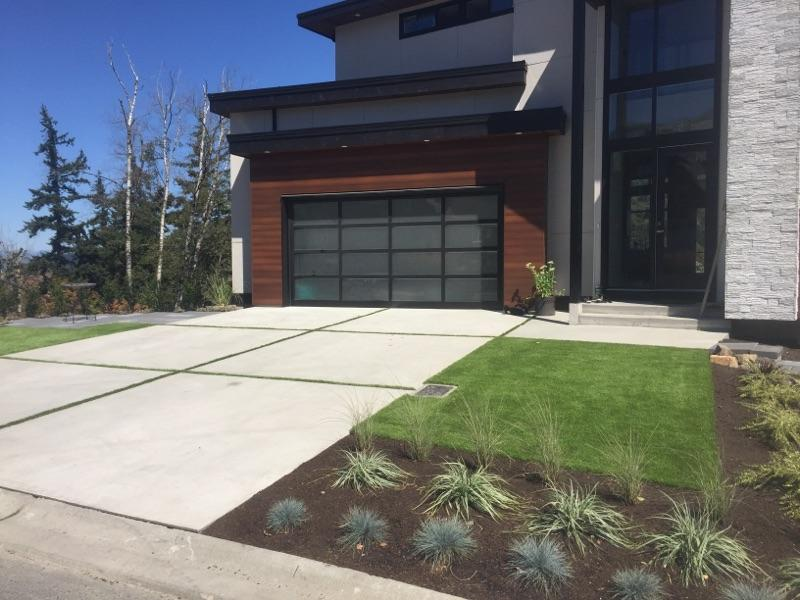 concrete driveway with grass side view