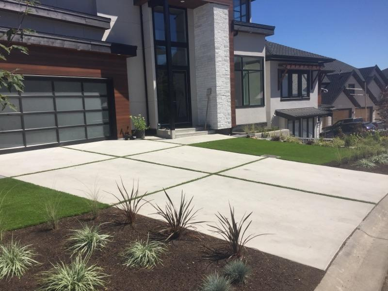 concrete driveway grass in middle side view