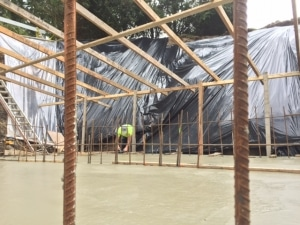 Pouring concrete retention tank at Stillwood Camp and Conference Centre.