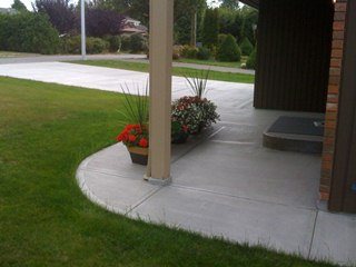 Matching broomed concrete sidewalk and driveway
