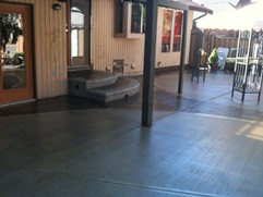 stamped concrete patio with broomed concrete