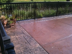 colored concrete with stamped concrete border pool deck