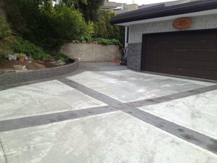 Driveway with stamped borders and retaining wall