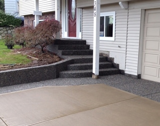 exposed aggregate stairs with retaining wall and driveway