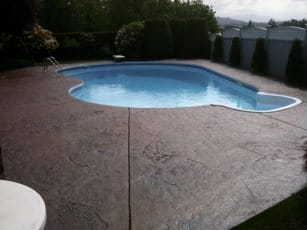 Stamped concrete pool deck with color and granite texture