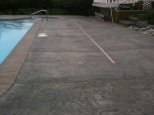 side view of stamped concrete pool deck
