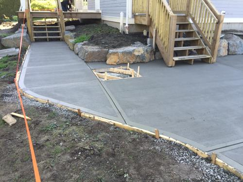 concrete driveway with wooden decks