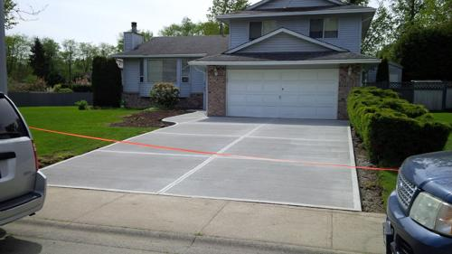 After picture of new broomed concrete driveway