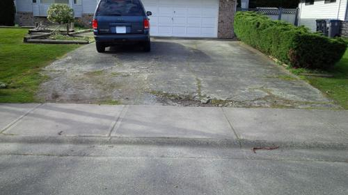 Before pictures of concrete driveway needing replacement