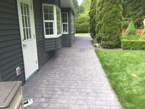Cobble stamped concrete sidewalk