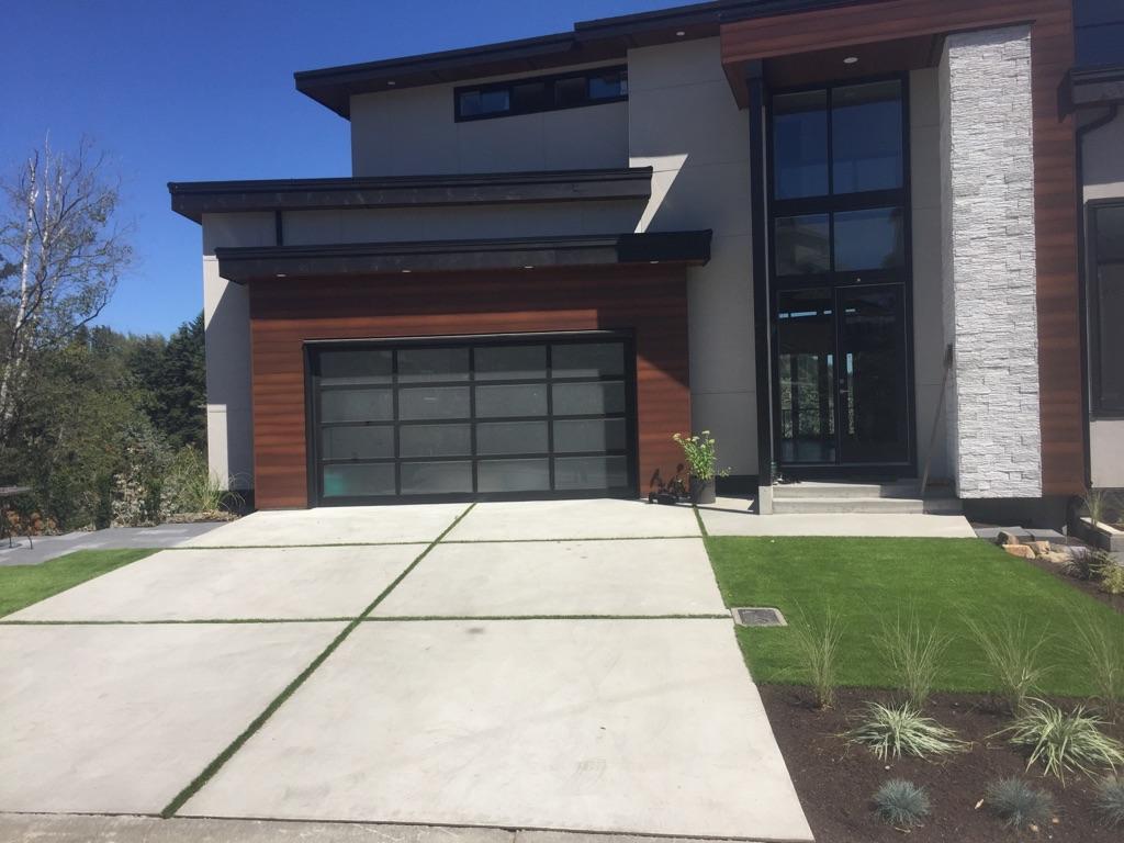 concrete driveway grass strips front view