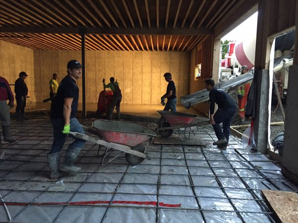 It's all hands on deck as we get ready to pour the concrete slab inside the shop.
